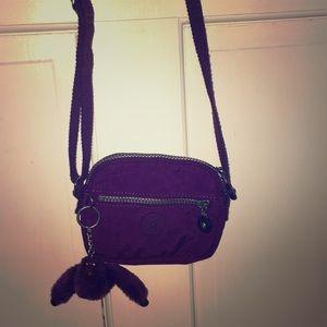 Kipling cross body bag, color is plum.